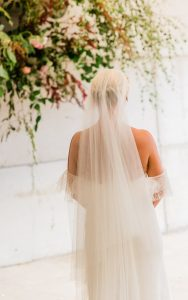 bride standing at alter